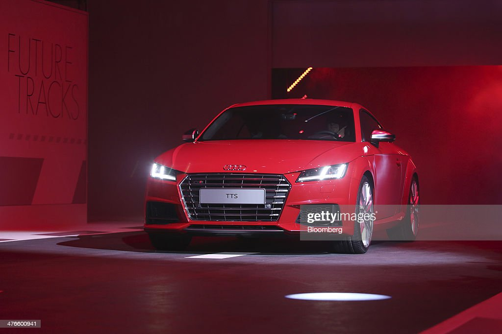 An Audi TTS automobile produced by Audi AG arrives on stage during a news conference ahead of the opening day of the 84th Geneva International Motor...