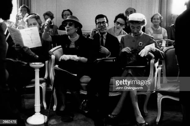 An audience at a Dior fashion show in Paris Lr Marie Louise Bousquet Paris Editor of Harper's Bazaar US photographer Richard Avedon and Carmel Snow...