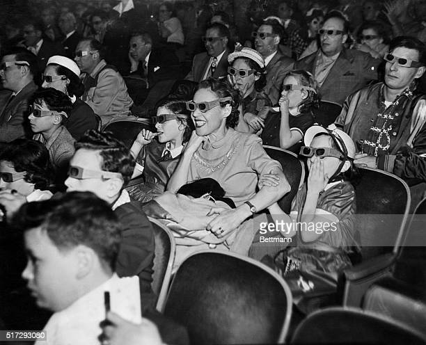 An audience enjoying a 3D movie in 1953
