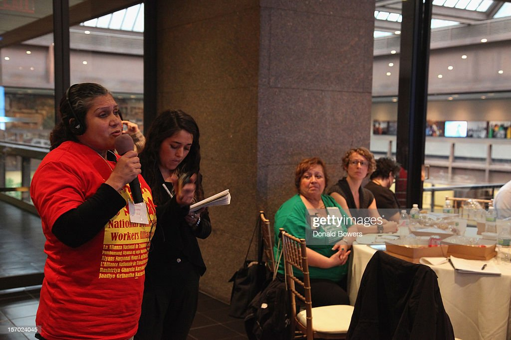An audience member asks a question during a panel at The Ford Foundation Hosts Day Of Discussion On The Hidden World Of Domestic Work In The US at Ford Foundation on November 27, 2012 in New York City.