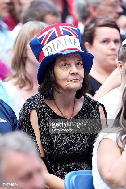 An audience member wearing a 'Diana' hat watches the Concert for Diana at Wembley Stadium on July 1 2007 in London England The Concert falls on the...