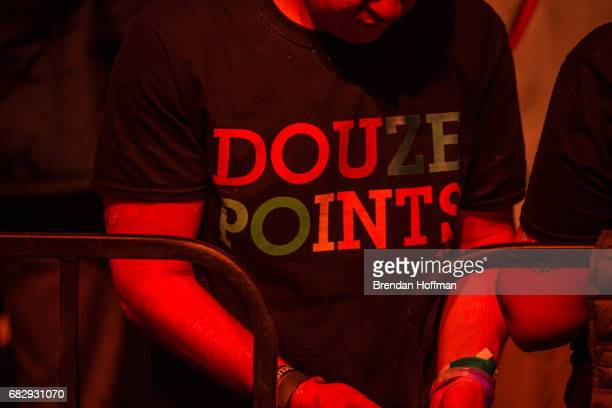 An audience member wears a shirt reading Douze Points shorthand for one country awarding the maximum twelve points to another at the Eurovision Grand...