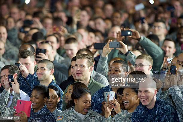 An audience of armed forces laughs during an address by US President Barack Obama December 15 2014 at Joint Base McGuireDixLakehurst New Jersey Obama...
