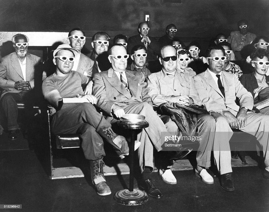 An audience watches the 3D movie 'Bwana Devil' at a screening in Hollywood