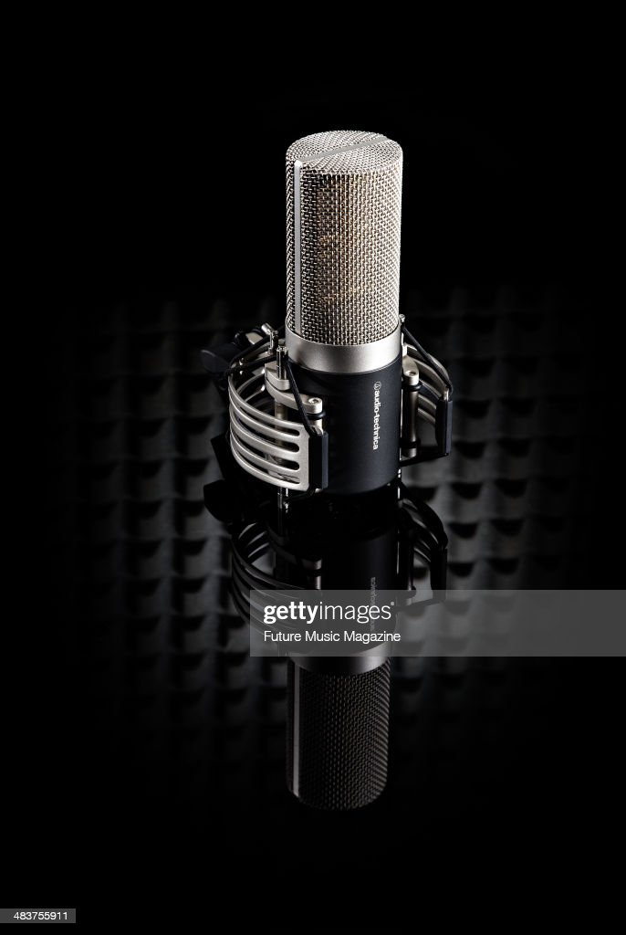 An Audio Technica AT5040 condenser microphone photographed on a black background taken on February 21 2013