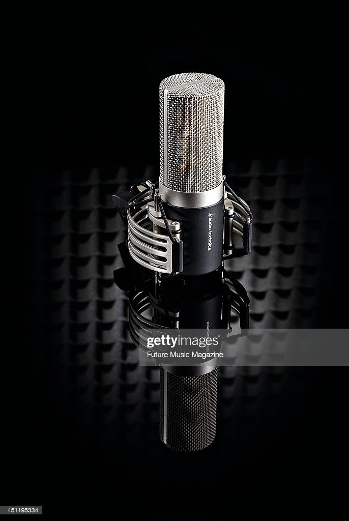 An Audio Technica AT5040 large capsule cardioid condenser microphone photographed on a black background taken on February 21 2013