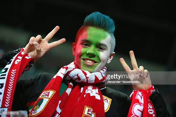 An Augsburg supporter soak up the atmosphere prior to the UEFA Europa League round of 32 first leg match between FC Augsburg and Liverpool at...