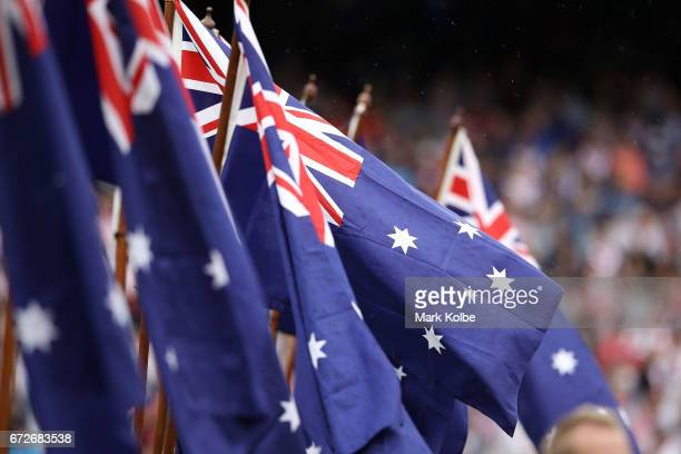 An Australia flag blows in the wind during the Anzac Day ceremony before the round eight NRL match between the Sydney Roosters and the St George...