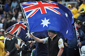 An Australia waves a flag during day one of the 3rd Investec Ashes Test match between England and Australia at Edgbaston on July 29 2015 in...