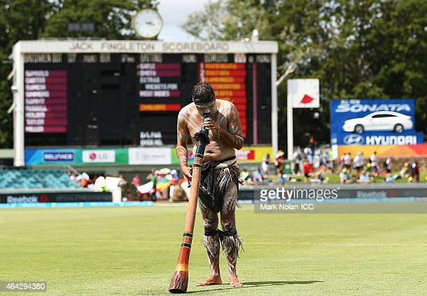 An Australian aboriginal plays the didgeridoo befoer the 2015 ICC Cricket World Cup match between the West Indies and Zimbabwe at Manuka Oval on...