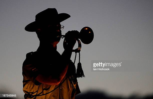 An Australian army soldier plays the the last post at the dawn service on April 25 2013 in Townsville Australia Veterans dignitaries and members of...