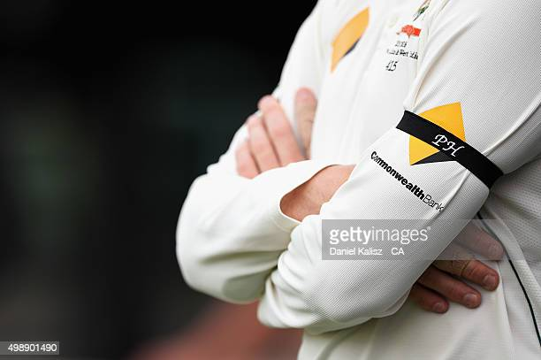 An Australian cricketer wears an armband as a sign of rememberance for the late Phillip Hughes during day one of the Third Test match between...