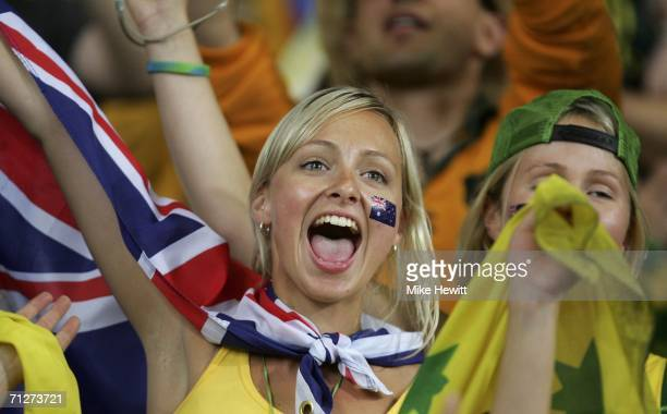 An Australian fan celebrates following her team's 22 draw during the FIFA World Cup Germany 2006 Group F match between Croatia and Australia at the...