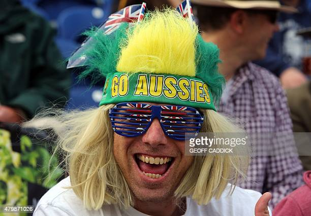An Australian fan smiles in the stands before play on the first day of the opening Ashes cricket test match between England and Australia at The...