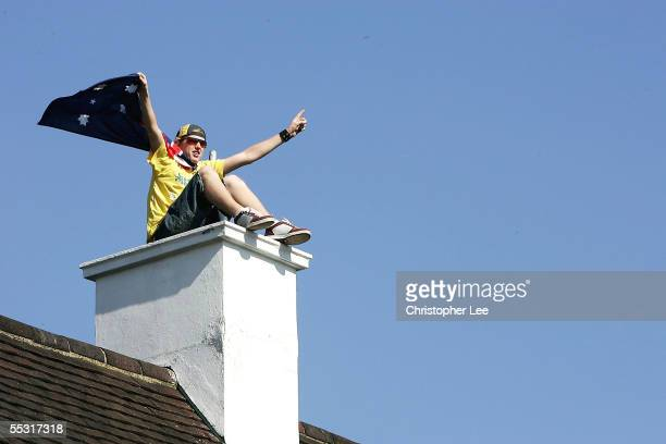An Australian fan watches the match from a roof top during the 5th npower Ashes Test Match between England and Australia at the Brit Oval on...
