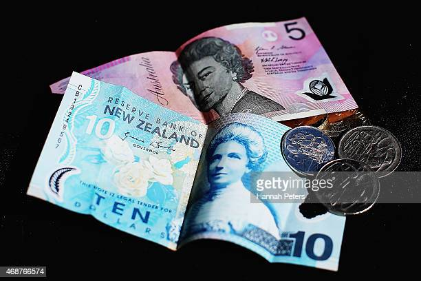 An Australian five dollar banknote a New Zealand ten dollar banknote and New Zealand coins are arranged for a photo on April 7 2015 in Auckland New...