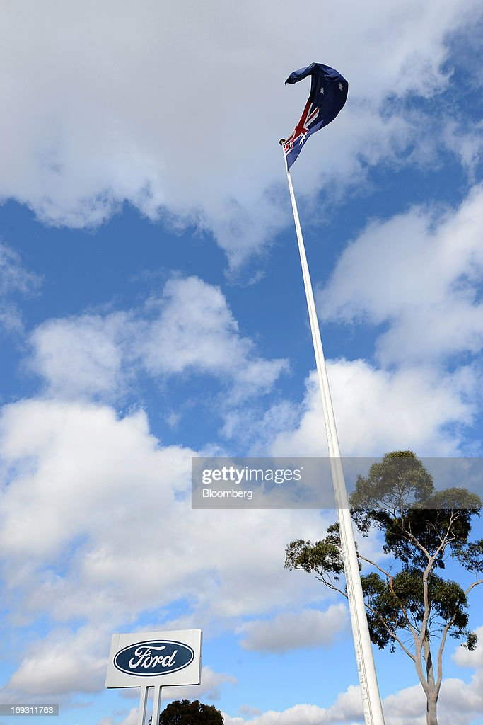 An Australian flag flies on a pole next to signage for Ford Motor Co. outside the company's Australia head office in Melbourne, Australia, on Thursday, May 23, 2013. Ford will stop making cars in Australia, nine decades after founder Henry Ford first began building Model Ts in the country, as a surge in the currency undermines the local industry's ability to compete with imports. Photographer: Carla Gottgens/Bloomberg via Getty Images