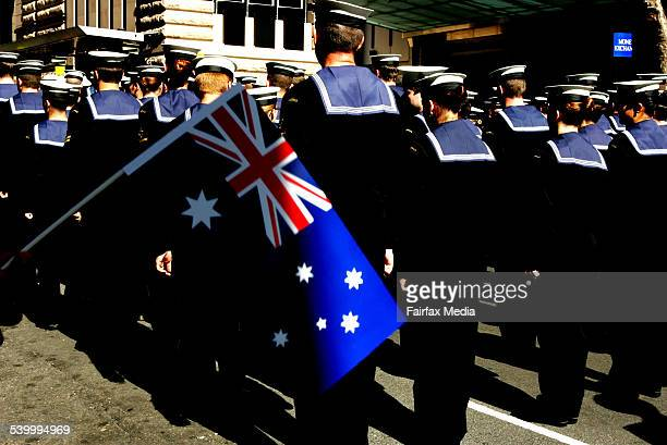An Australian flag flutters in the breeze during the Anzac Day march through the streets of Sydney 25 April 2005 AFR Picture by TAMARA VONINSKI