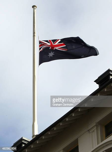 An Australian flag flys at halfmast as a sign of respect at Treasury Place on July 19 2014 in Melbourne Australia At least 28 Australians were on...