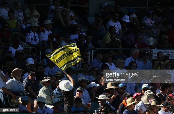 An Australian flag is seen during game three of the One Day International Series between Australia and South Africa at Manuka Oval on November 19...