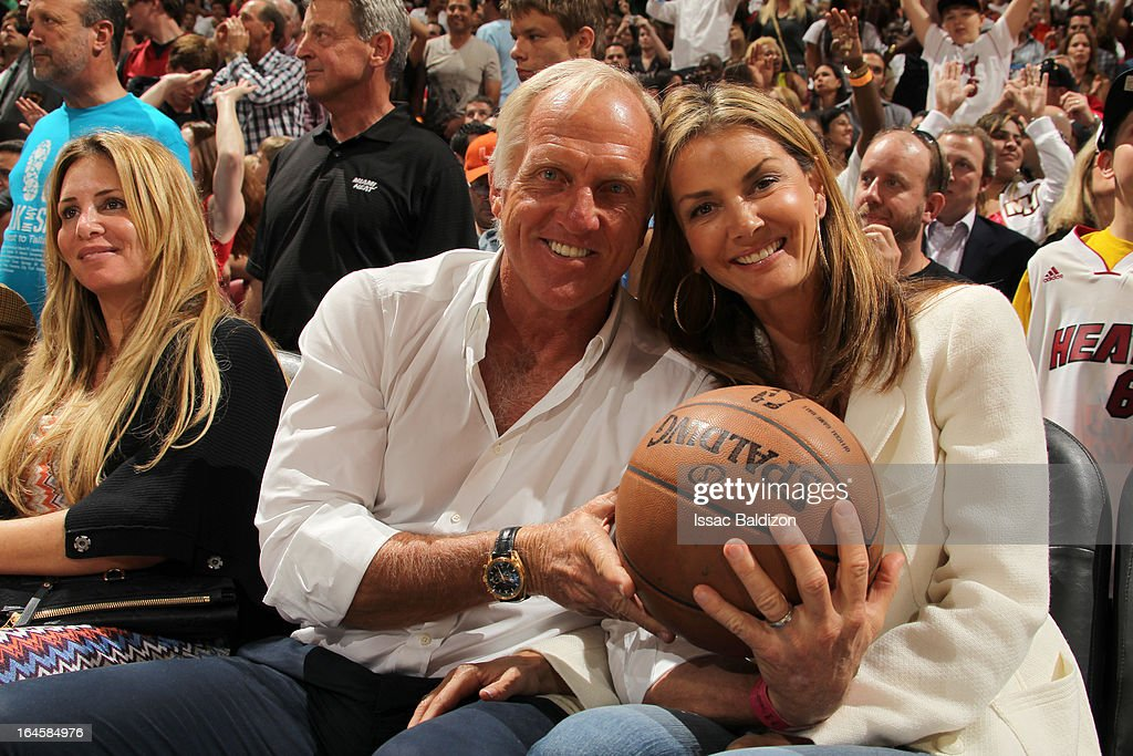 An Australian golfer <a gi-track='captionPersonalityLinkClicked' href=/galleries/search?phrase=Greg+Norman&family=editorial&specificpeople=201538 ng-click='$event.stopPropagation()'>Greg Norman</a> attends a game between the Charlotte Bobcats and the Miami Heat on March 24, 2013 at American Airlines Arena in Miami, Florida.