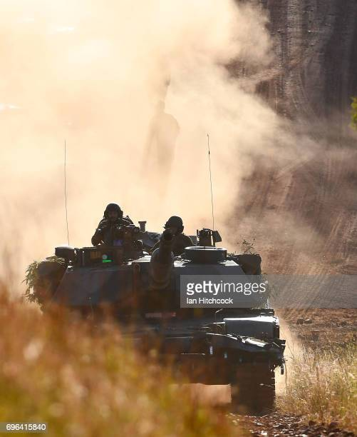 An Australian M1 Abrams tank is seen driving up a dirt road during the 3rd Brigade Live Fire Exercise 'Brolga Strike' on June 16 2017 in Townsville...