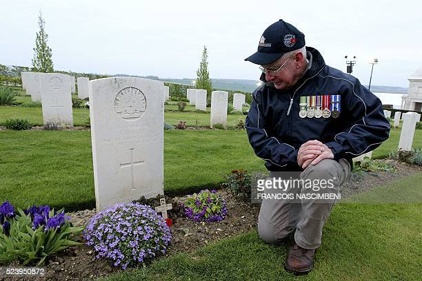 An Australian man kneels down next to a grave during the Anzac day in tribute of Australians and New Zealanders soldiers killed in combat at the...