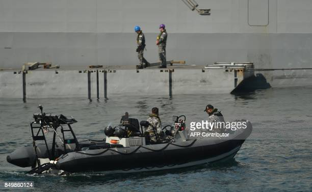 An Australian Navy patrol boat sits next to a navy ship on Sydney harbour on September 20 2017 A major attack in Australia is 'inevitable' one of the...