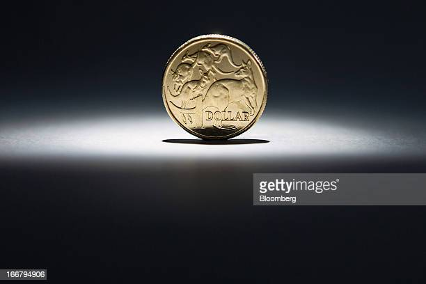 An Australian onedollar coin is arranged for a photograph in Sydney Australia on Wednesday April 17 2013 Direct trading between the Australian dollar...