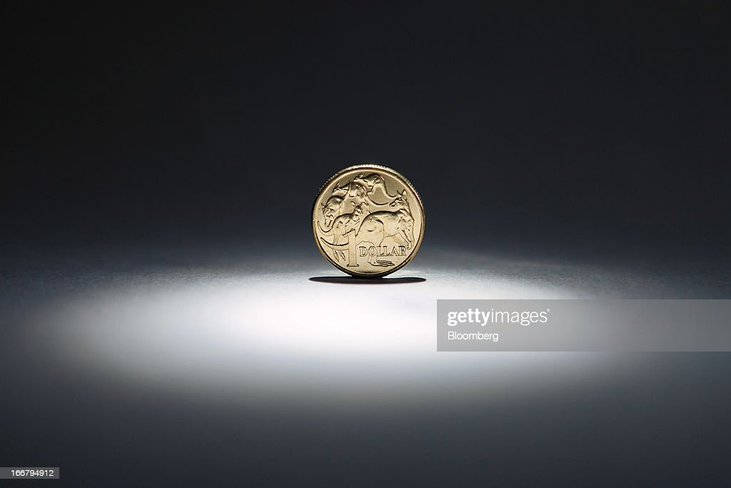 An Australian one-dollar coin is arranged for a photograph in Sydney, Australia, on Wednesday, April 17, 2013. Direct trading between the Australian dollar and yuan started on April 10. Photographer: Ian Waldie/Bloomberg via Getty Images