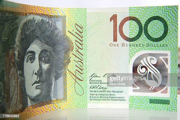 An Australian onehundred dollar banknote is arranged for a photograph in Melbourne Australia on Thursday Aug 15 2013 The Australian dollar has...