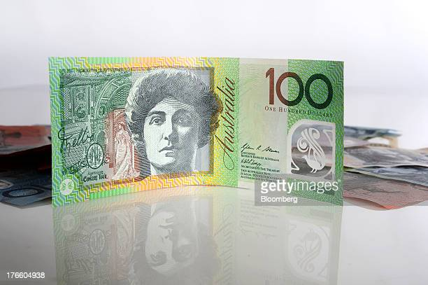 An Australian onehundred dollar banknote is arranged for a photograph in front of banknotes of other denominations in Melbourne Australia on Thursday...