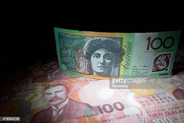 An Australian onehundred dollar banknote top and New Zealand onehundred dollar banknotes are arranged for a photograph in Hong Kong China on Thursday...