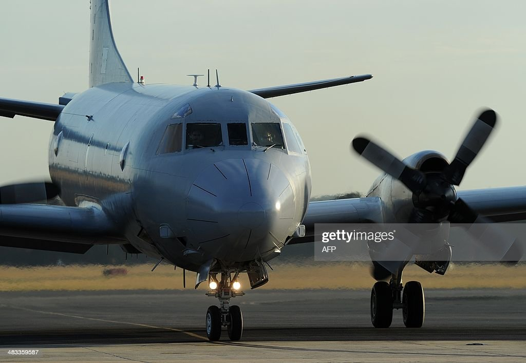 An Australian Orion aircraft arrives back at Pearce Airbase in Bullsbrook 35 kms north of Perth on April 8 2014 after assisting in the search for...