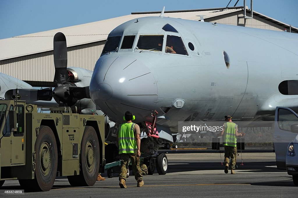 An Australian Orion aircraft is moved to a new position at Pearce Airbase in Bullsbrook 35 kms north of Perth on April 8 2014 The hunt for missing...