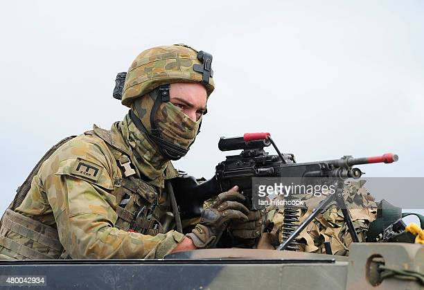 An Australian soldier from 7 Brigade operates a machine gun through the turret of a truck as part of exercise Talisman Sabre on July 9 2015 in...