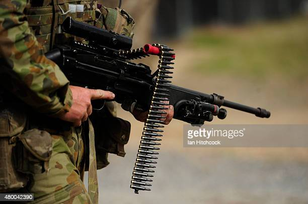 An Australian soldier is seen carrying a Minimi mahine gun as part of exercise Talisman Sabre on July 9 2015 in Rockhampton Australia Talisman Sabre...
