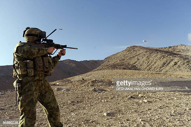 An Australian soldier of the Omletc Company takes part in practice shooting at the forward operating base in southern Uruzgan province's Mirwais on...