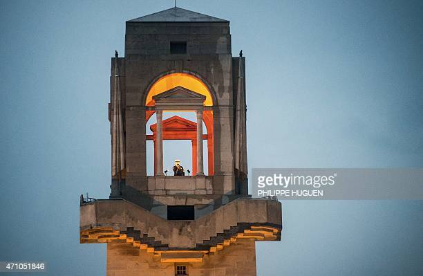 An Australian soldier plays the bugle from the top of the Australian National Memorial' tower during a dawn ceremony marking the 100th anniversary of...