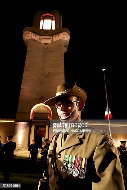 An Australian soldier poses at the Australian Memorial of the World War I battle of the Somme in VillersBretonneux on April 25 2016 during the Anzac...