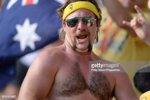 An Australian spectator with a moustache and a partially waxed chest making a bikini shape pictured during the 1st Ashes cricket Test match between...