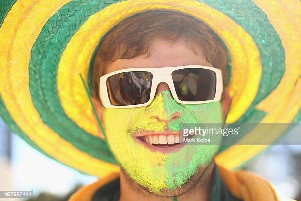 An Australian supporter poses as he arrives for the 2015 ICC Cricket World Cup final match between Australia and New Zealand at Melbourne Cricket...