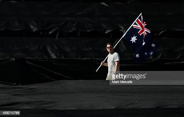 An Australian supporter walks in the stands during game three of the One Day International Series between Australia and South Africa at Manuka Oval...
