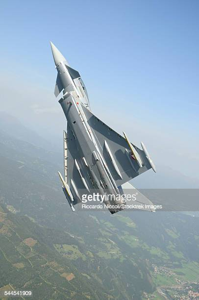 An Austrian Air Force Eurofighter EF2000 Typhoon during a step climb over the Austrian Alps.