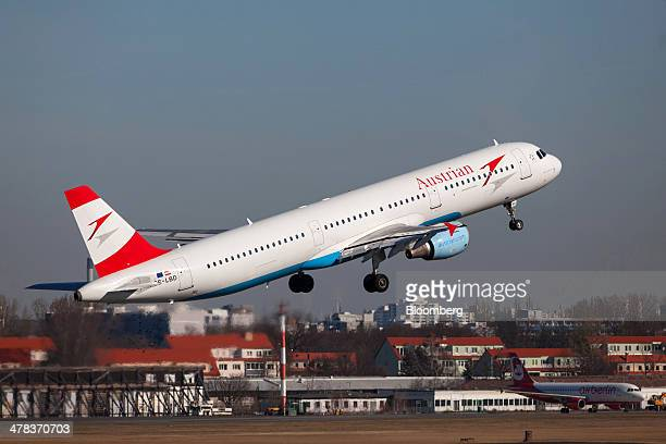 An Austrian Airlines AG passenger aircraft operated by Deutsche Lufthansa AG takes off from Tegel airport operated by Flughafen Berlin Brandenburg...