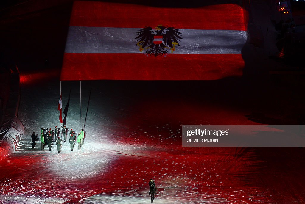 An Austrian flag is hoisted during the opening ceremony of the FIS World Ski Championships on February 4, 2013 in Schladming. AFP PHOTO OLIVIER MORIN
