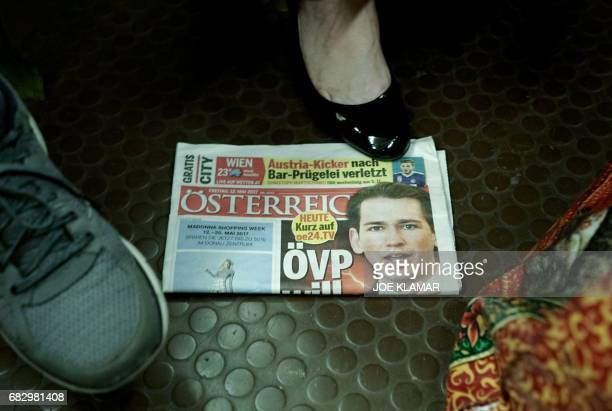 An Austrian newspaper depicting Austrian Foreign Minister Sebastian Kurz on the front page lies on the floor on the subway in Vienna ahead of Kurz's...