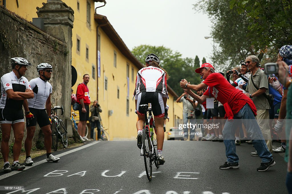 An Austrian riders receives some support during training on day five of the UCI Road World Championships on September 26, 2013 in Florence, Italy.