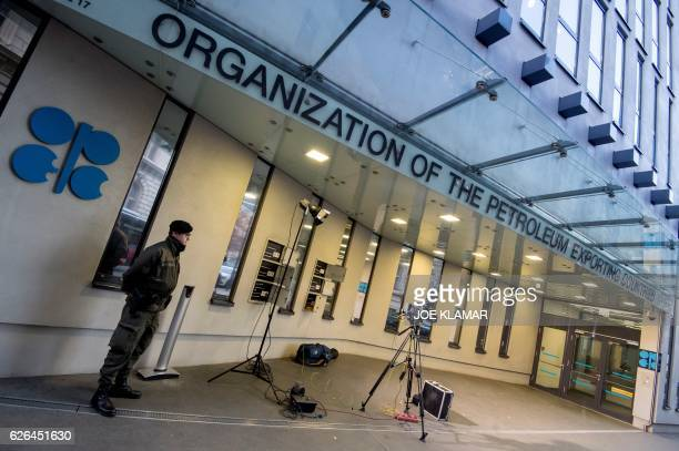 An Austrian soldier stands guard outside the OPEC headquarters on the eve of the 171th meeting of the Organization of the Petroleum Exporting...