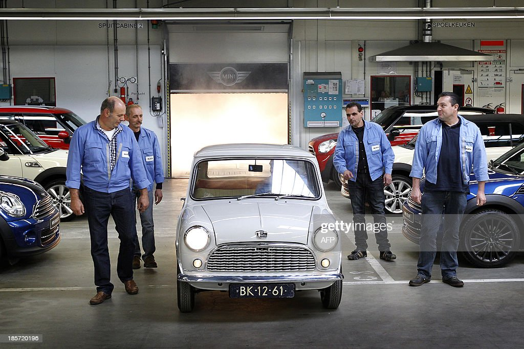 An authentic classic Mini is displayed at a VDL Nedcar plant in Born on October 24, 2013. Specialists from VDL Nedcar have restored the Austen Seven from 1959 and the car is one of the oldest of this type in the world. The car manufacturing plant will produce certain Mini models in the Limburg factory from 2014 onwards.